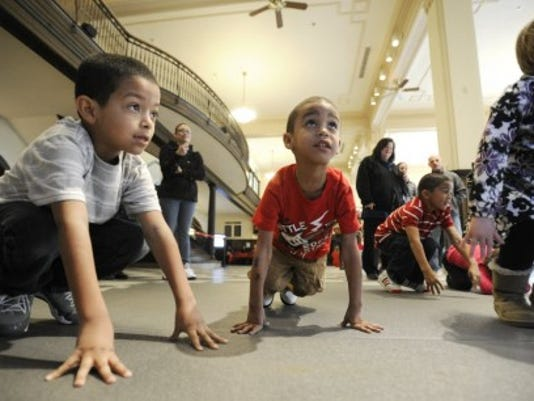 Miguel Rivera, 6, left, and Richard Craighead, 4, exercise at the Ready, Set, Explore event in February 2013 at the Susan P. Byrnes Health Education Center in York. (Daily Record/Sunday News -- Jason Plotkin)