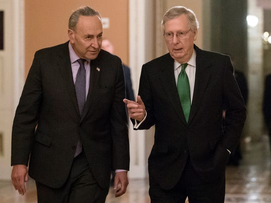 Senate Minority Leader Chuck Schumer, D-N.Y., left, and Senate Majority Leader Mitch McConnell, R-Ky., walk to the chamber after collaborating on an agreement in the Senate on a two-year, almost $400 billion budget deal that would provide Pentagon and domestic programs with huge spending increases, at the Capitol on Feb. 7, 2018.