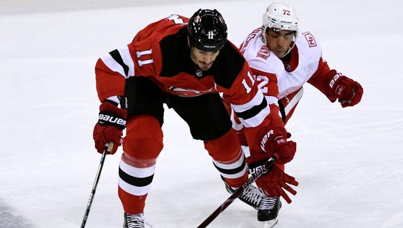 New Jersey Devils center Brian Boyle (11) and Detroit