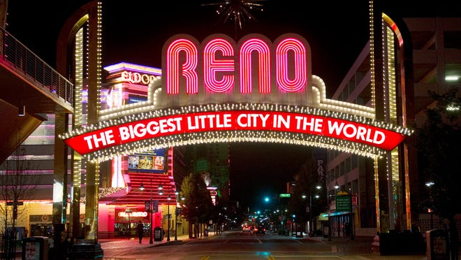A shot of the iconic Reno Arch on Virginia Street in downtown Reno.