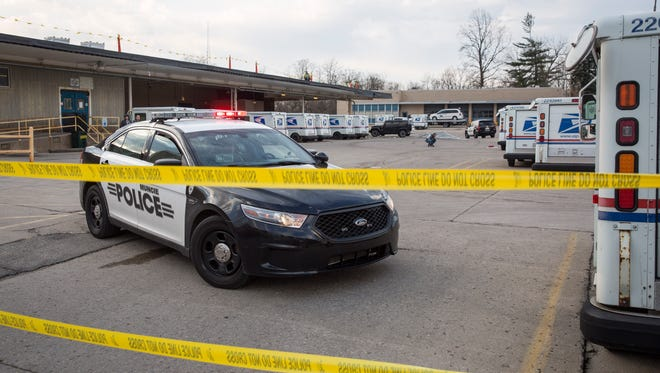 Police investigate a police-action shooting March 24 after a brief pursuit that saw the suspect's car crash through the fence of the U.S. Post Office along Memorial Drive. The man was treated at IU Health Ball Memorial Hospital before being transferred to the county jail.