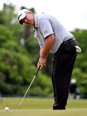 Boo Weekley hits a putt on the 11th hole during the first round of the Zurich Classic at TPC Louisiana. Weekley was one of two golfers to shoot 8-under 64 Thursday.