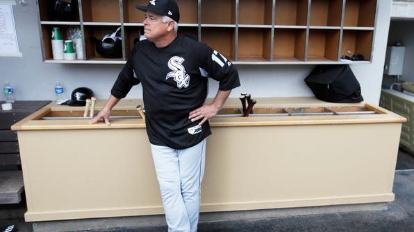 Chicago White Sox manager Rick Renteria waits for the start of a spring training baseball game against the Chicago Cubs Monday, Feb. 27, 2017, in Mesa, Ariz. (AP Photo/Morry Gash)