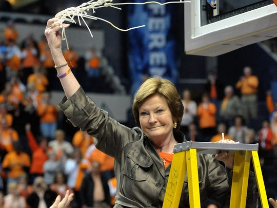 Legendary Tennessee Lady Volunteers head coach Pat Summitt cuts down and waves the net after her team defeated the LSU Tigers 70-58 during the finals of the 2012 SEC Tournament at Bridgestone Arena. Summitt, 64, died Tuesday.