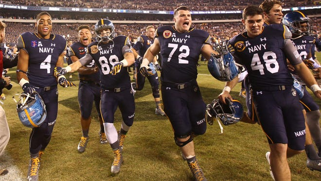 Adam West (72) celebrates after Navy's win in the 2015 Army-Navy game in Philadelphia. In 2016, West will start on the offensive line.