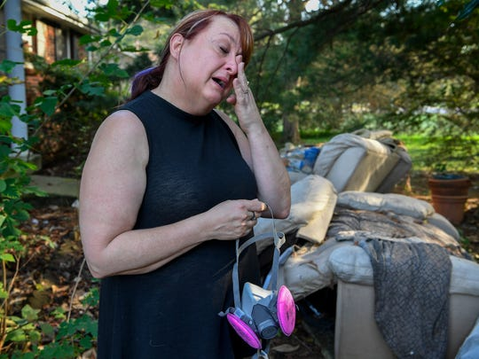 Maria McClure cries as she talks about the alleged abuse her father went through as she stands outside his home in Clarksville, Tenn., on Monday, Oct. 9, 2017.