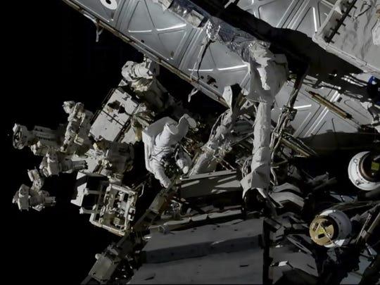 Canadian astronaut David Saint-Jacques, center left,
