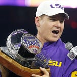 LSU Tigers head coach Les Miles holds the Texas Bowl trophy after LSU defeated the Texas Tech Red Raiders in the 2015 Texas Bowl.