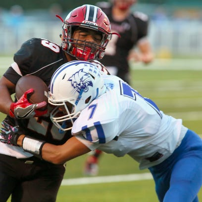 Coshocton senior Kobie Means carries the ball Friday