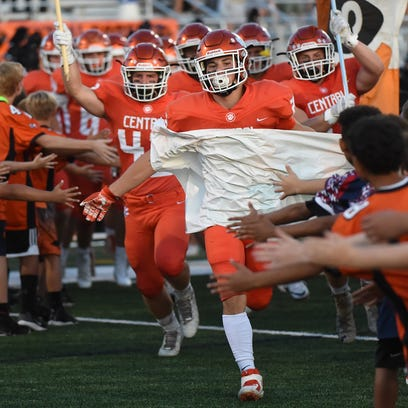 The Central York football team is greeted by area youth