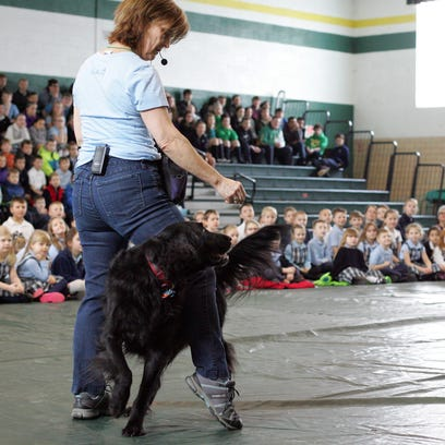 Julie Fudge Smith, owner of A Positive Connection in Granville, brought her dogs Mr. Bingley, a flat-coated retriever, and Buckley, a bernese mountain dog, to St. Francis as a way of teaching students lessons of gentleness.