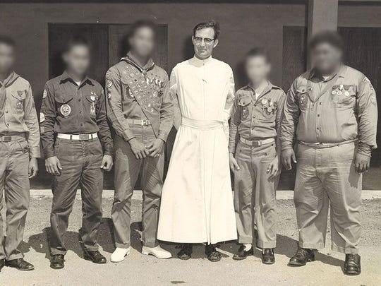 Father Louis Brouillard with members of the Boy Scouts of America in an undated PDN photo