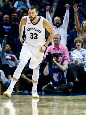 Memphis Grizzlies center Marc Gasol celebrates a basket against the Orlando Magic defense during fourth quarter action at the FedExForum in Memphis, Tenn., Wednesday, November 1, 2017.