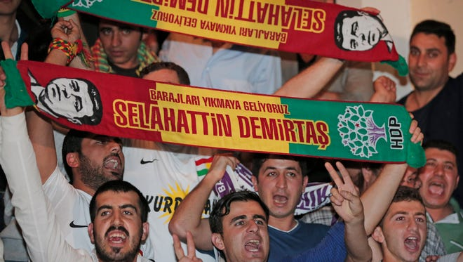 Supporters of the pro-Kurdish Peoples' Democratic Party, (HDP) celebrate in Istanbul, late Sunday, June 7, 2015. In a stunning blow to President Recep Tayyip Erdogan, preliminary results from Turkey's parliamentary election on Sunday show his party lost its simple majority in Parliament.