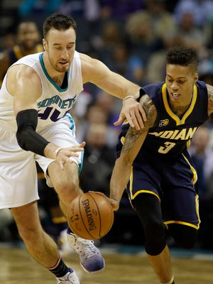The Pacers' Joe Young (right) and the Hornets' Frank Kaminsky  chased a loose ball Monday night. Young got control, but the team committed 18 turnovers that were a big factor in the Pacers' 122-100   loss at Charlotte.