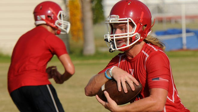 Cocoa Beach's David Demeter runs the ball during an early-August practice.