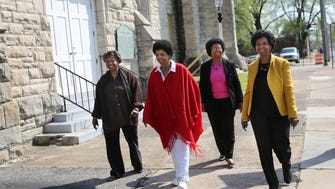 March 23, 2017 - After visiting Clayborn Temple, Ernestine Lee Henning (left), Brenda Lee Turner, Peggy Lee and Elaine Lee Turner walk up Hernando in downtown Memphis.  The sisters are in town for Saturday's unveiling of a historical marker at Main and Gayoso.