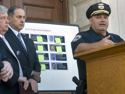 From the left, Tom Kearney, York County District Attorney, Sam Rabadi, special agent of the Philadelphia office for the ATF and York City Police Chief Wes Kahley talk about arrests in front of York City Police in York September 23, 2014. (Daily Record/Sunday news -- File)