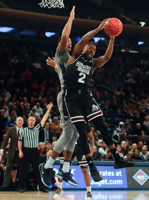 Mississippi State guard Eli Wright (2) grabs a rebound next to Penn State forward Julian Moore (44) during the first half of an NCAA college basketball game in the semifinals of the NIT, Tuesday, March 27, 2018, in New York. (AP Photo/Julie Jacobson)