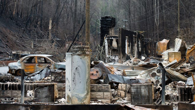 Destroyed homes near the downtown area of Gatlinburg, Tenn., are shown Dec. 5, 2016. A week ago on Monday, hurricane-force winds whipped up fires that killed 14 people and damaged or destroyed almost 1,700 buildings in the Great Smoky Mountains tourist region.