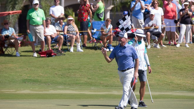 PGA Tour Pro Jerry Kelly waves to the crowd after sinking a putt on No. 9 during the final round of the Chubb Classic at TwinEagles Club Sunday, Feb. 19, 2017 in Naples.