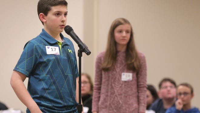 Drew Johnson of Wynford Middle School competes in the Tri County Spelling Bee on Thursday.