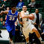 Forward J.J. Avila drives past Georgia State's Markus Crider during a game last season at Moby Arena. Avila was one of three seniors from last year's 27-7 CSU team who participated in pre-draft workouts Wednesday and Thursday with the Denver Nuggets.
