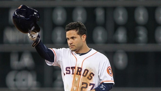 Astros second baseman Jose Altuve tips his helmet after hitting a double. Altuve tied an Astros record with 210 hits in a season.