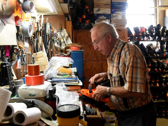 Elton Griffith repairs a pair of skates in the equipment