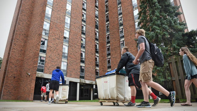 People move their belongings into Sherburne Hall Thursday, Aug. 17, during move-in day for new students at St. Cloud State University.