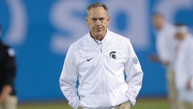 Michigan State coach Mark Dantonio watches his team warm up before the San Diego County Credit Union Holiday Bowl against Washington State on Thursday, Dec. 28, 2017, at SDCCU Stadium in San Diego.