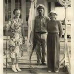 Cecil and Talbot Bunting, left and center, former owners of the Talbot Street Pier, pose with an unknown angler and a white marlin.