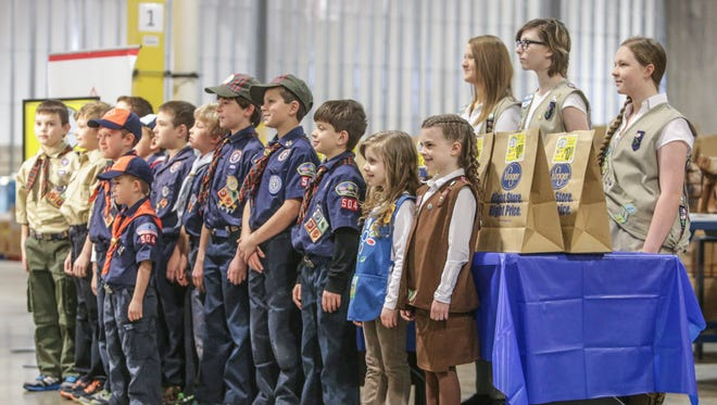 """Tuesday March 25th, 2014, Scouts pose for photos during the kick off the 28th annual """"Scouting For Food"""" drive. Representatives from The Boy Scouts, Girl Scouts, Kroger, and Gleaner's Food Bank, gathered at Gleaners Food Bank of Indiana to kick off the 28th annual """"Scouting For Food"""" drive."""