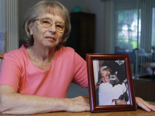 JoAnn Zywicki with a picture of her daughter Tammy
