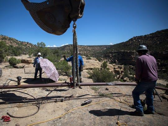 Harpole Construction Inc., employees prepare to remove