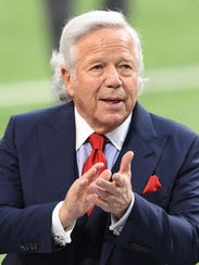 New England Patriots owner Robert Kraft looks on from
