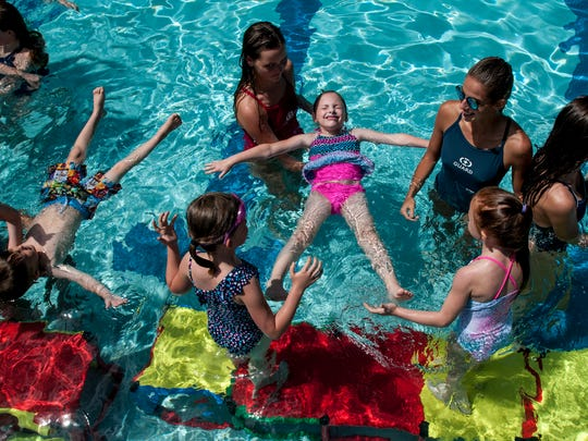 Riley Morden, 7, of Port Huron, floats on her back during a swim class Monday, June 19, 2017, at Sanborn Pool in Port Huron.
