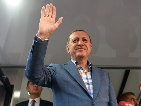 Turkish President Recep Tayyip Erdogan delivers a speech n Istanbul, Saturday, July 16, 2016. Forces loyal to Erdogan quashed a coup attempt in a night of explosions, air battles and gunfire that left some hundreds of people dead and scores of others wounded Saturday. The chaos Friday night and Saturday came amid a period of political turmoil in Turkey _ a NATO member and key Western ally in the fight against the Islamic State group _ that critics blame on Erdogan's increasingly authoritarian rule.