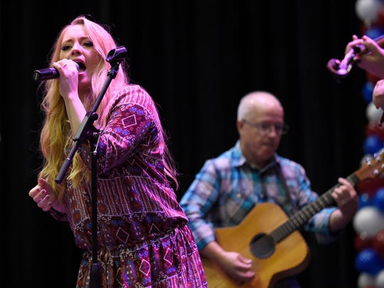 American Idol finalist Janelle Arthur, left, performs on stage during the Duncan Family Barbecue at the Knoxville Civic Coliseum on Tuesday, Oct. 7, 2014.