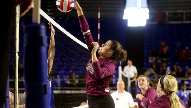 Eagleville's Tori Laidig (30) tips the ball over the net in the  losers bracket game of the TSSAA Class A state volleyball tournament against Summertown, on Thursday, Oct. 22, 2015, at MTSU.