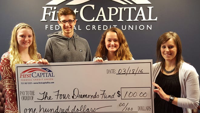 Pictured, from left, are: West York students and student council officers Madison Weinstein, Jack Seifarth and Madison Miller; and Lisa Barshinger, of First Capital Federal Credit Union.