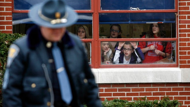 Students wait to be released from Martinsville West Middle School after it had been locked down following a school shooting Friday, March 25, 2011.  The student who was shot, Chance Jackson, was in critical condition as police questioned another student suspected of pulling the trigger.
