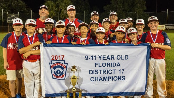 Port St Lucie National Little League 11U team was District 17 Champions. The team went 6-0 in the district tournament. From left, Nathan Gould, Edgar Aguero, Keenan Jabeth, Ryan Winsker, Roger Perez, Sebastien Germano, Cheeky Rojas, Edgardo Otero, Ethan Schmidt, Nathaniel Morel, Connor Cantillo, Charlie Passanante,  Robbie MacLellan, Quinn Bostic, John Riordan III. Back from left, manager John Riordan, coach Mike Winsker, coach Eric Schmidt and coach Ace Singleton. The team will be playing in the sectional tournament at Sportsmans Park in Port St. Lucie on Saturday.