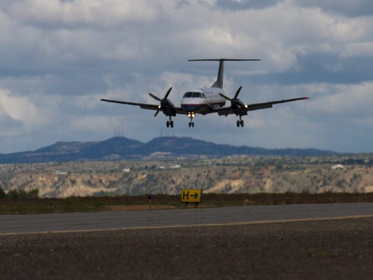 A Great Lakes Airline carrying lands, Thursday, May 18, 2017 at the Four Corners Regional Airport in Farmington.