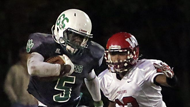Collins' Kenterious Rhodes runs the ball during Friday's game against West Marion at Collins.