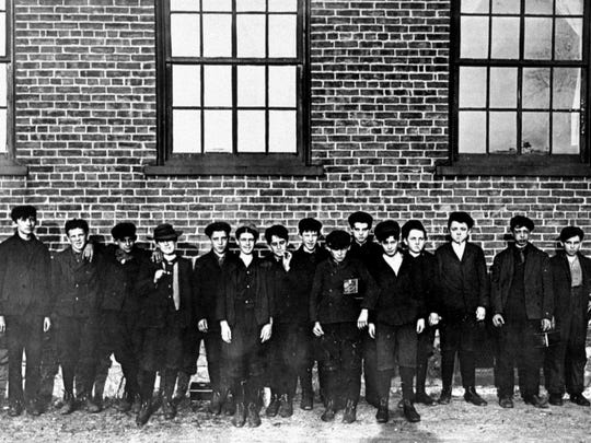 A 1909 photo of boys working in Chace Cotton Mill in Burlington.