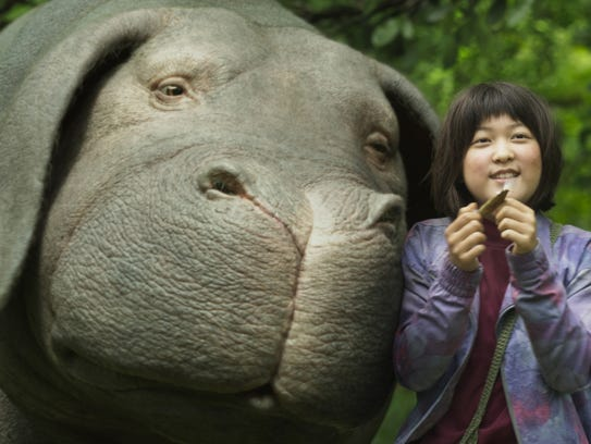 Mija (An Seo Hyun) raises 'super pig' Okja in the mountains
