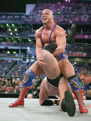 Kurt Angle puts Brock Lesnar in an ankle lock at WrestleMania XIX in Seattle in a match that paired two wrestlers who were first decorated in the amateur ranks.