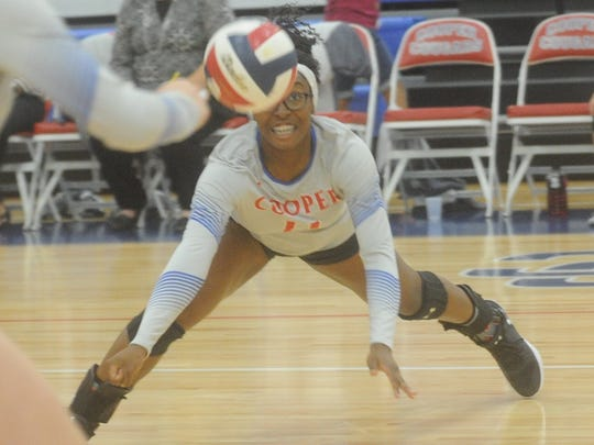 Cooper's Daniece Edwards dives for a ball against Wichita Falls Hirschi. Cooper swept Hirschi 25-20, 25-16, 25-14 in the nondistrict match Tuesday, Sept. 19, 2017 at Cougar Gym.