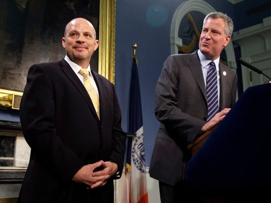 In this file photo, New York City Mayor Bill de Blasio, right, and United Federation of Teachers President Michael Mulgrew appear at a news conference at City Hall in New York.